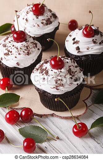 Beautiful Chocolate Cupcakes With White Cream And Cherry Vertical