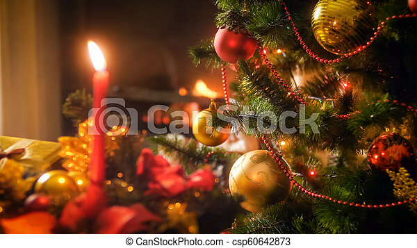 Burning Christmas Tree.Beautiful Christmas Background With Burning Candles Fireplace And Decorated Christmas Tree