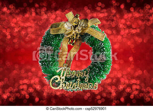 Beautiful Christmas crown isolated on red blurred background - csp52976901