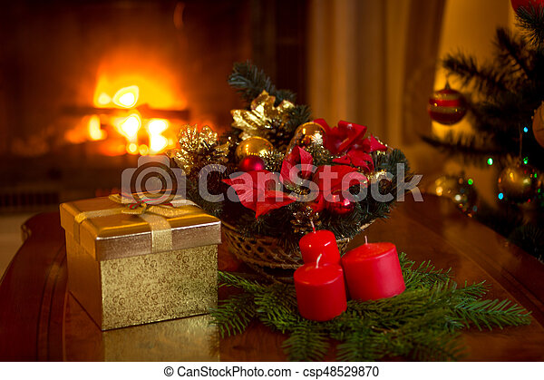Burning Christmas Tree.Beautiful Christmas Tree And Stack Of Presents In Front Of Burning Fireplace