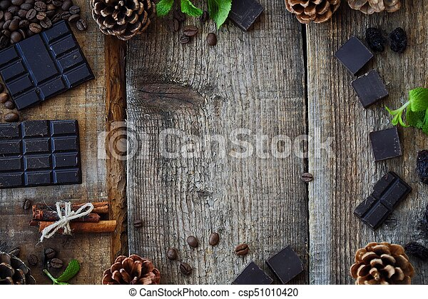 Beautiful Christmas wooden background with pine cones - csp51010420