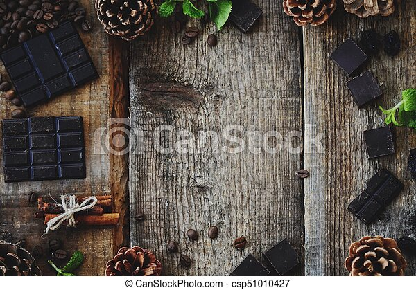 Beautiful Christmas wooden background with pine cones - csp51010427