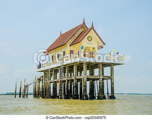 Beautiful church in the sea on blue sky background - csp20340975
