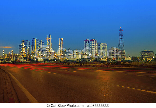 beautiful city scape of road and land transportaiton against lighting of oil refinery industry plant  use as energy and fuel power topic background - csp35865333