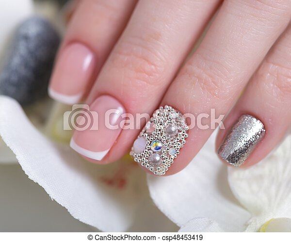 Beautiful Classic French Manicure With Rhinestones On Female Hand Close Up