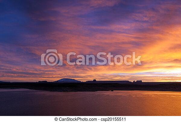 Beautiful classic sunrise over hills and lake - csp20155511