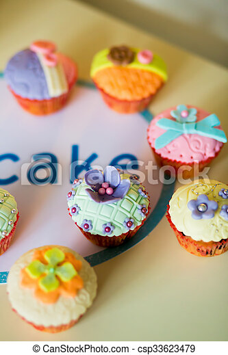 Beautiful, colorful, delicious Cupcakes on the table - csp33623479