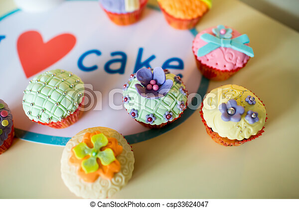 Beautiful, colorful, delicious Cupcakes on the table - csp33624047