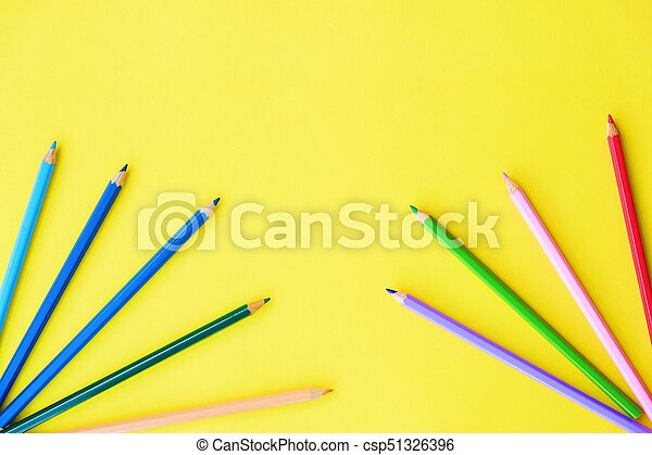 Beautiful colorful pencils on yellow background view - csp51326396