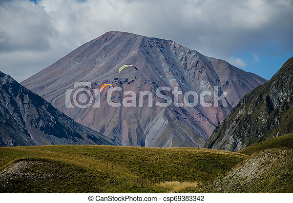 Beautiful colourful mountains viewed from the Russia Georgia Friendship Monument in Kazbegi. - csp69383342