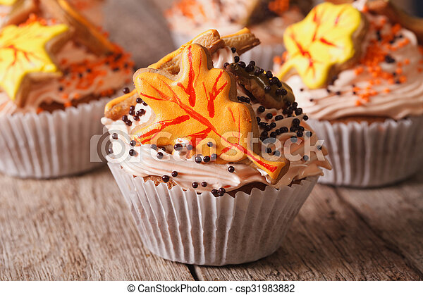 Beautiful cupcakes decorated with autumn leaves close up. horizontal - csp31983882