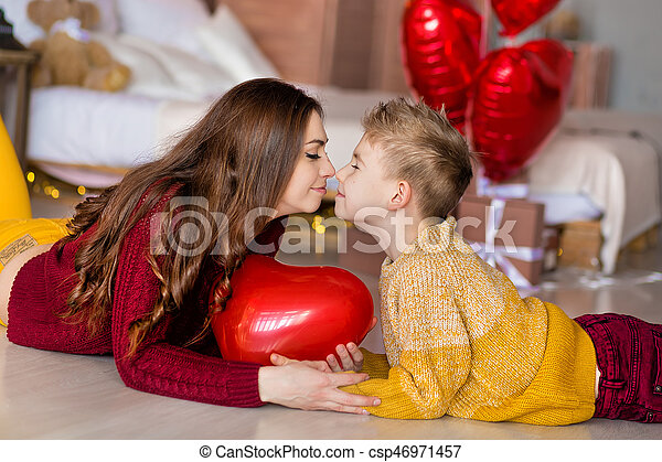 Beautiful Cute Young Brunette Mom Mother With Her Teenager Handsome Boy Holding Each Other And Happy Stock Photo
