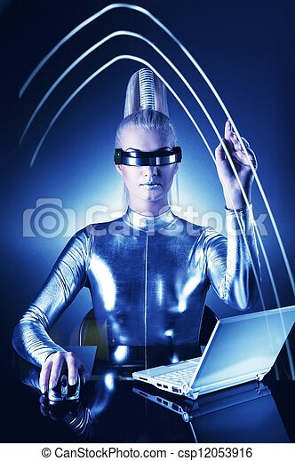 Beautiful cyber woman pointing at something - csp12053916