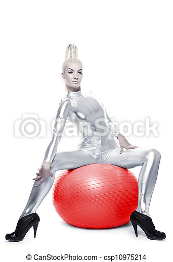 Beautiful cyber woman sitting on a red ball - csp10975214