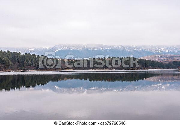 Beautiful dam in Bulgaria in winter. - csp79760546