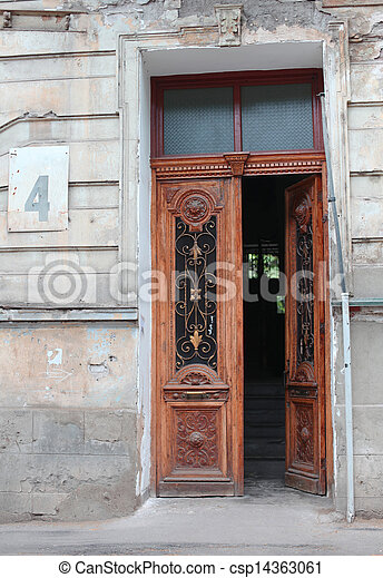 Beautiful door of an pld house with number plate - csp14363061