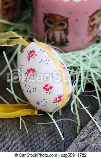 Beautiful Easter egg on a wooden table - csp55911782