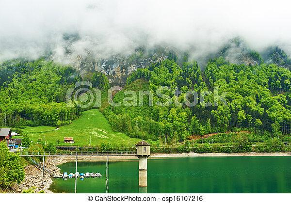 Beautiful emerald mountain lake in Switzerland - csp16107216