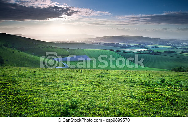 Beautiful English countryside landscape over rolling hills - csp9899570