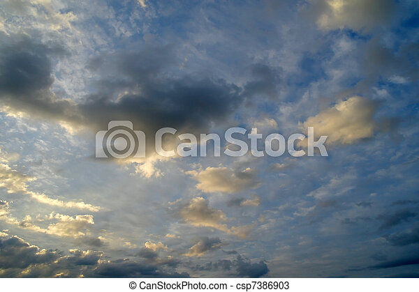 Beautiful evening clouds in the sky - csp7386903