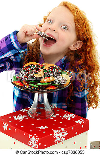 Beautiful Excited Girl Child in Pajamas with a Tray of Holiday Cookies over white background.  - csp7838055