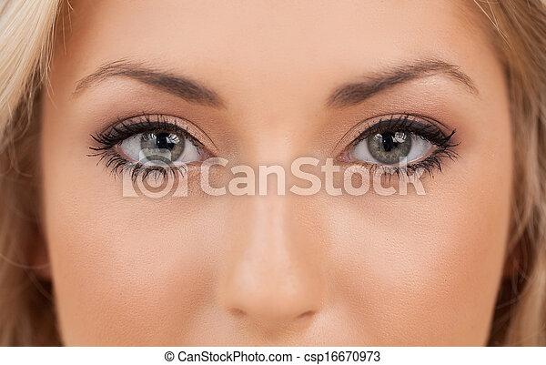 Beautiful eyes. Close-up on woman looking at camera - csp16670973