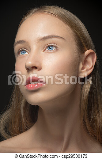 Beautiful face of young woman with clean fresh skin close up - csp29500173