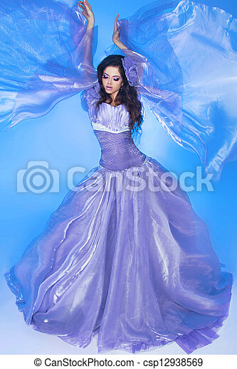 Beautiful  . Fashion woman in Blowing Dress Flying - csp12938569
