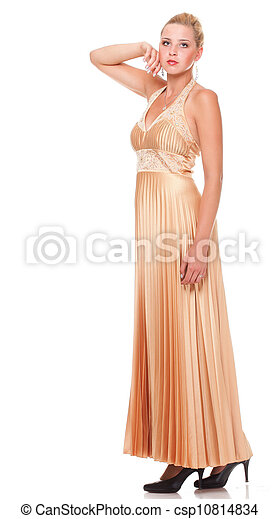 Beautiful female blonde fashion model in yellow dress isolated - csp10814834