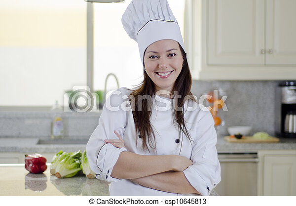 Beautiful Female Chef In A Kitchen Young Happy Chef Working In A Kitchen Canstock