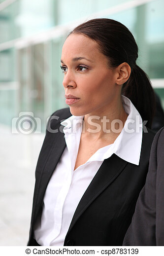Beautiful female executive outside a corporate building - csp8783139
