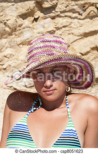 Beautiful female woman with straw hat posing - csp8051623
