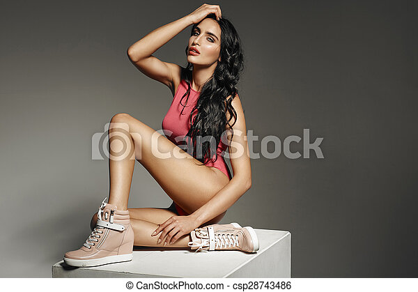 Beautiful fit brunette girl with long hair - csp28743486
