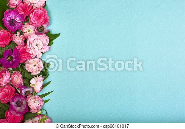 beautiful floral background texture wallpaper flat lay of pink flowers on blue background top view copy space greeting card or wedding invitation