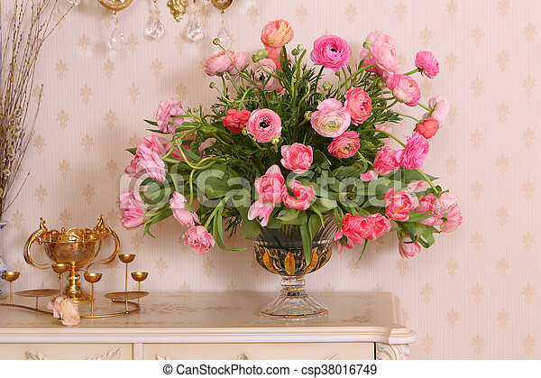 beautiful flowers in a vase on a white table - csp38016749