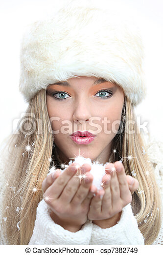 beautiful girl blowing christmas or new year wishes - csp7382749
