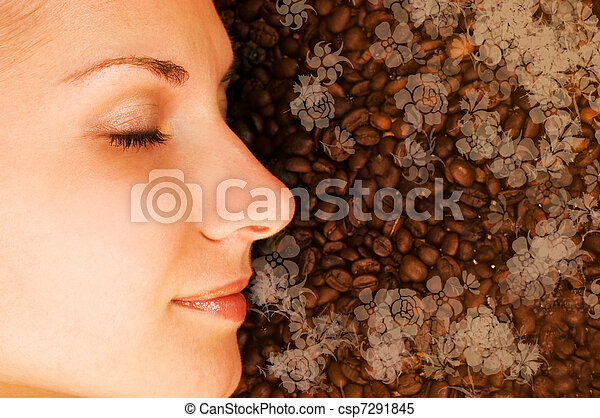 Beautiful girl breathing in scent of coffee - csp7291845
