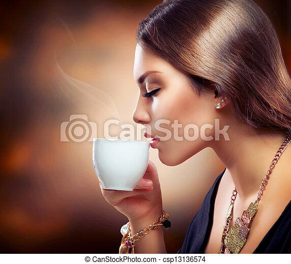 Beautiful Girl Drinking Tea or Coffee  - csp13136574