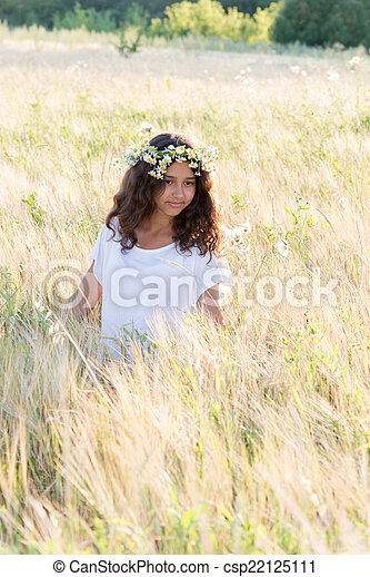 Beautiful girl in a field on  summer day - csp22125111