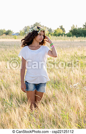 Beautiful girl in a field on  summer day - csp22125112