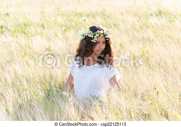 Beautiful girl in a field on  summer day - csp22125113
