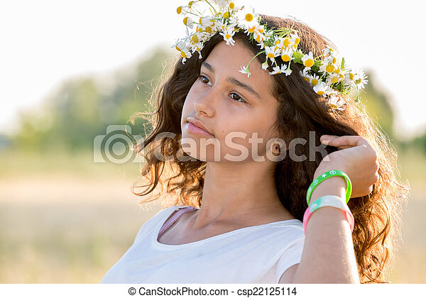 Beautiful girl in a field on  summer day - csp22125114