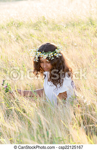 Beautiful girl in a field on  summer day - csp22125167