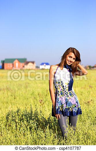 Beautiful girl in a field - csp4107787