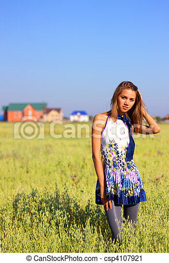 Beautiful girl in a field - csp4107921