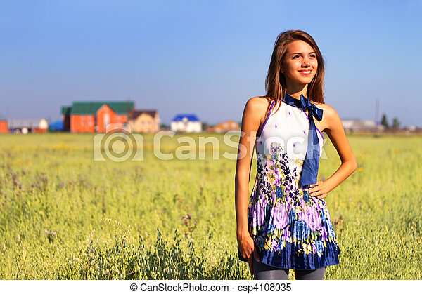 Beautiful girl in a field - csp4108035