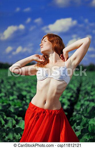 Beautiful girl in a field - csp11812121