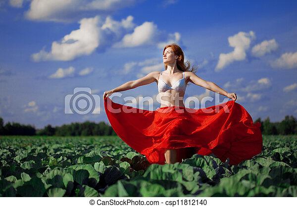 Beautiful girl in a field - csp11812140