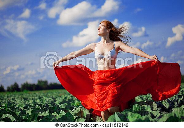 Beautiful girl in a field - csp11812142