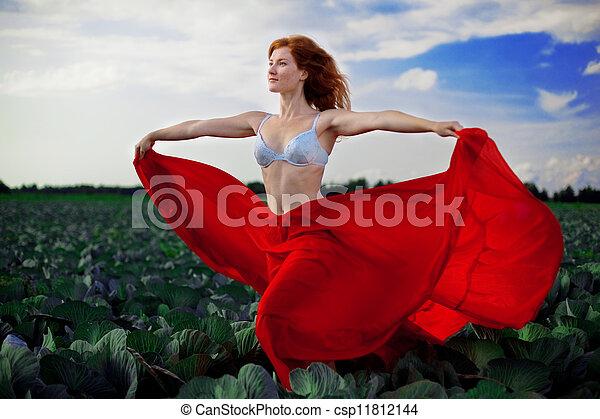 Beautiful girl in a field - csp11812144